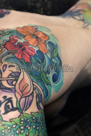 nude tattooed woman