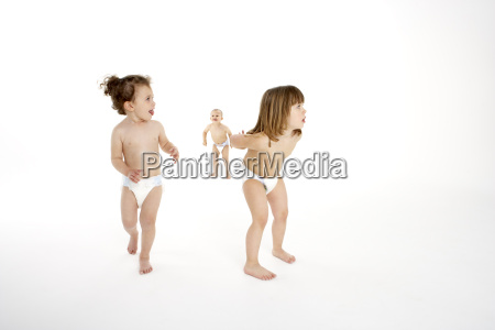 three young children playing in studio