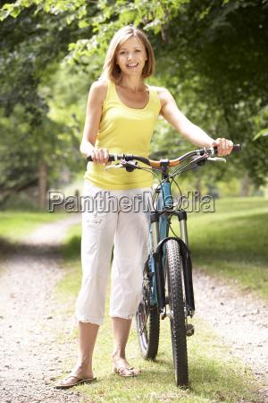 woman riding bike in countryside