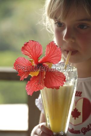 girl enjoying smoothie