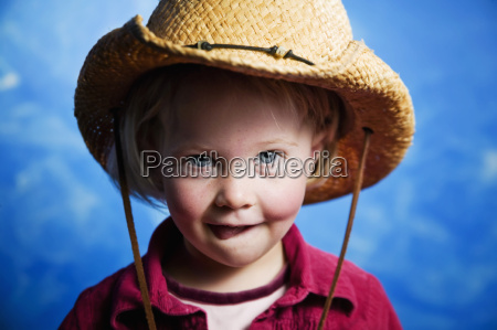little girl in front of blue