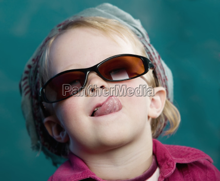 little girl sticking out her tongue