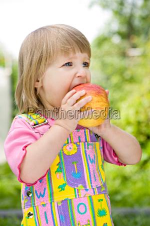 little girl in a multi coloured