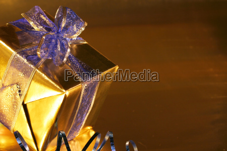 elegant gold present with blue ribbons