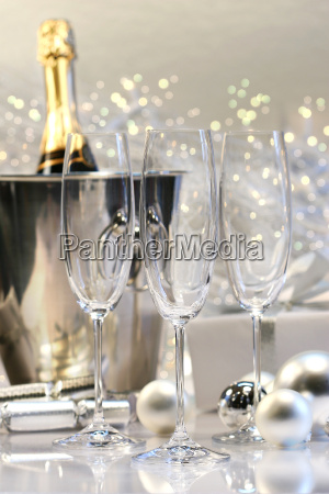 three empty champagne glasses ready to