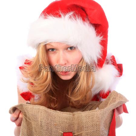 ueberraschtes fraeulein sankt mit weihnachtstasche