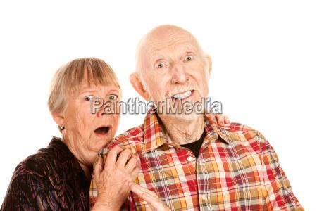 shocked senior couple