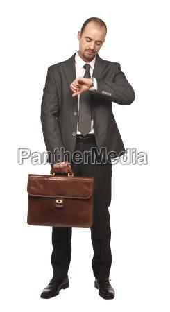 businessman look his watch