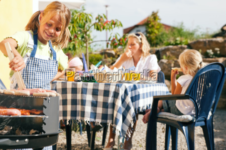 family barbecuing