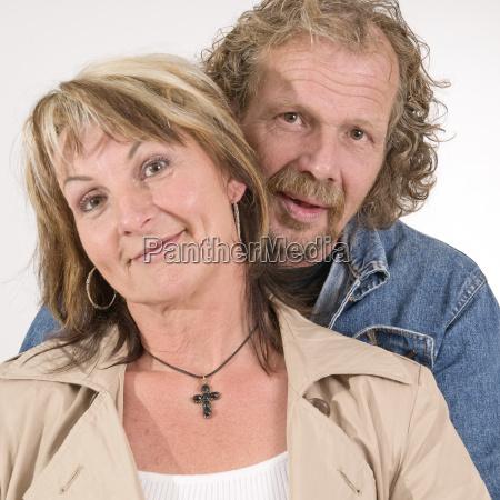 man behind woman