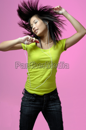 young woman is dancing to mp3
