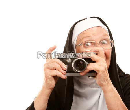 nun with old camera