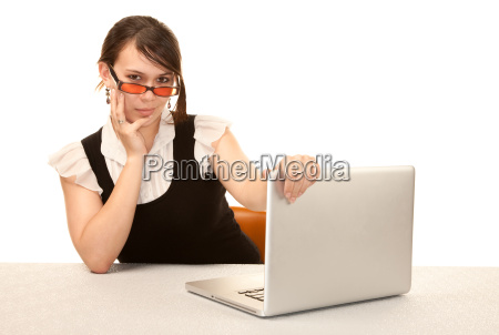 pretty female office worker with laptop