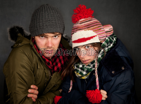 hipster couple in clothing for cold