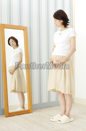 pregnant woman watching a mirror