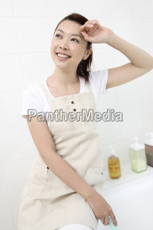 woman doing bathroom cleaning