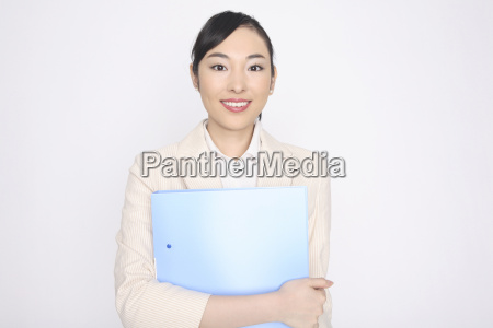 business lady holding a file with