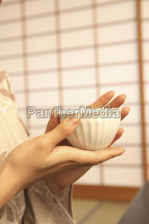 hand of woman having a teacup