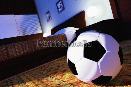 soccer ball in a bedroom