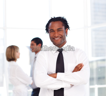 african businessman with folded arms smiling