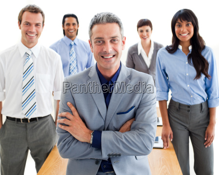 smiling manager with folded arms in