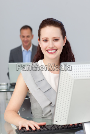 sparkling businesswoman smiling at the camera