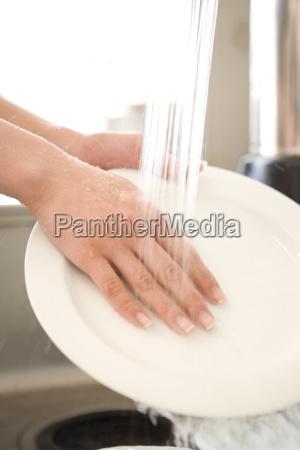 japanese woman washing a dish