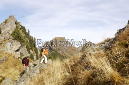 young couple hiking in mountains side