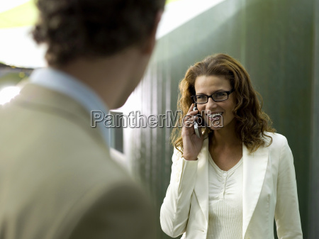 businesswoman and businessman woman using mobile