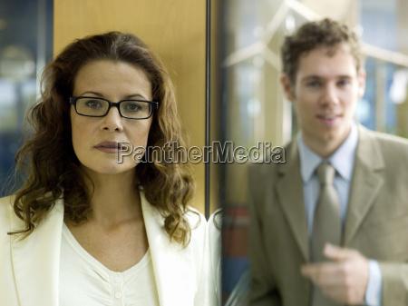 businesswoman and businessman man standing behind