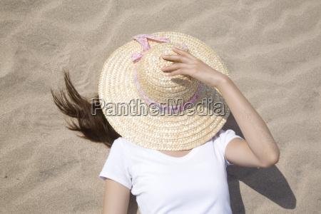 japanese woman lying on a beach