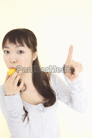 japanese young woman blowing a whistle