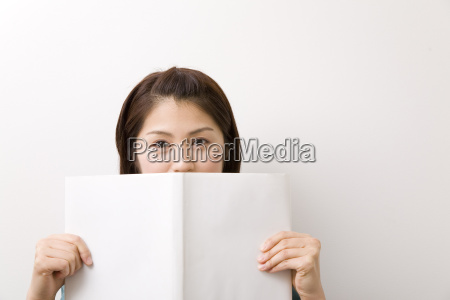 japanese young woman reading a book