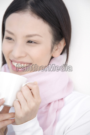 woman gripping a coffee cup