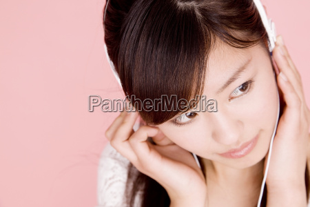 japanese young woman listening to the