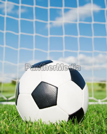football in the goal with blue