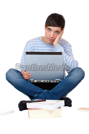young handsome student sitting frustrated on