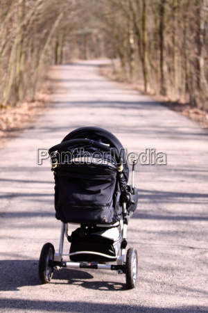 perambulator in the forest with way