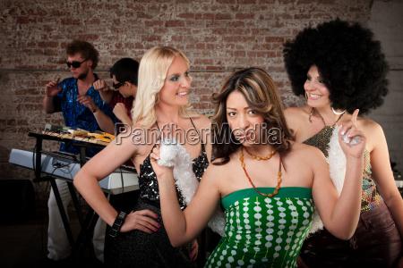 blowing a kiss at 1970s disco