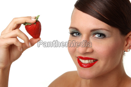 laughing woman with strawberry