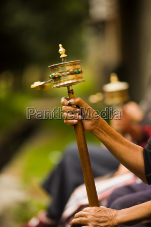 tibetan prayer wheel spinning