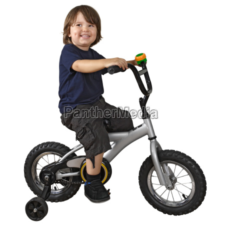 cute boy riding bicycle