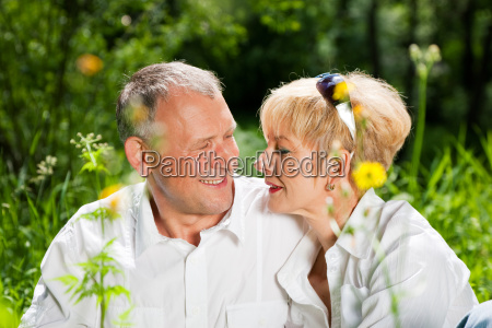 elderly couple in nature