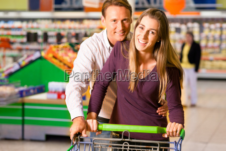 couple in the supermarket with shopping