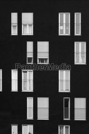 windows on a black wall