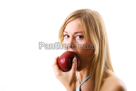 woman is biting into apple