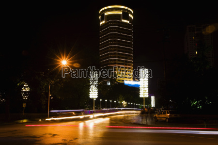 buildings lit up at night hefei