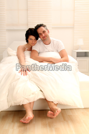 couple sitting in bed