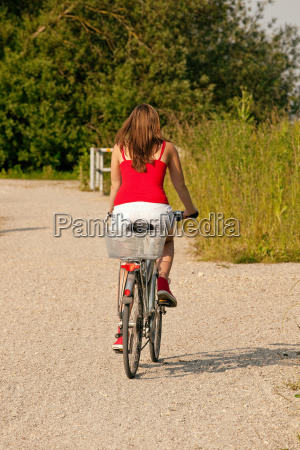 woman riding the bicycle in summer