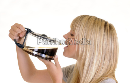 young blond woman drinks coffee from
